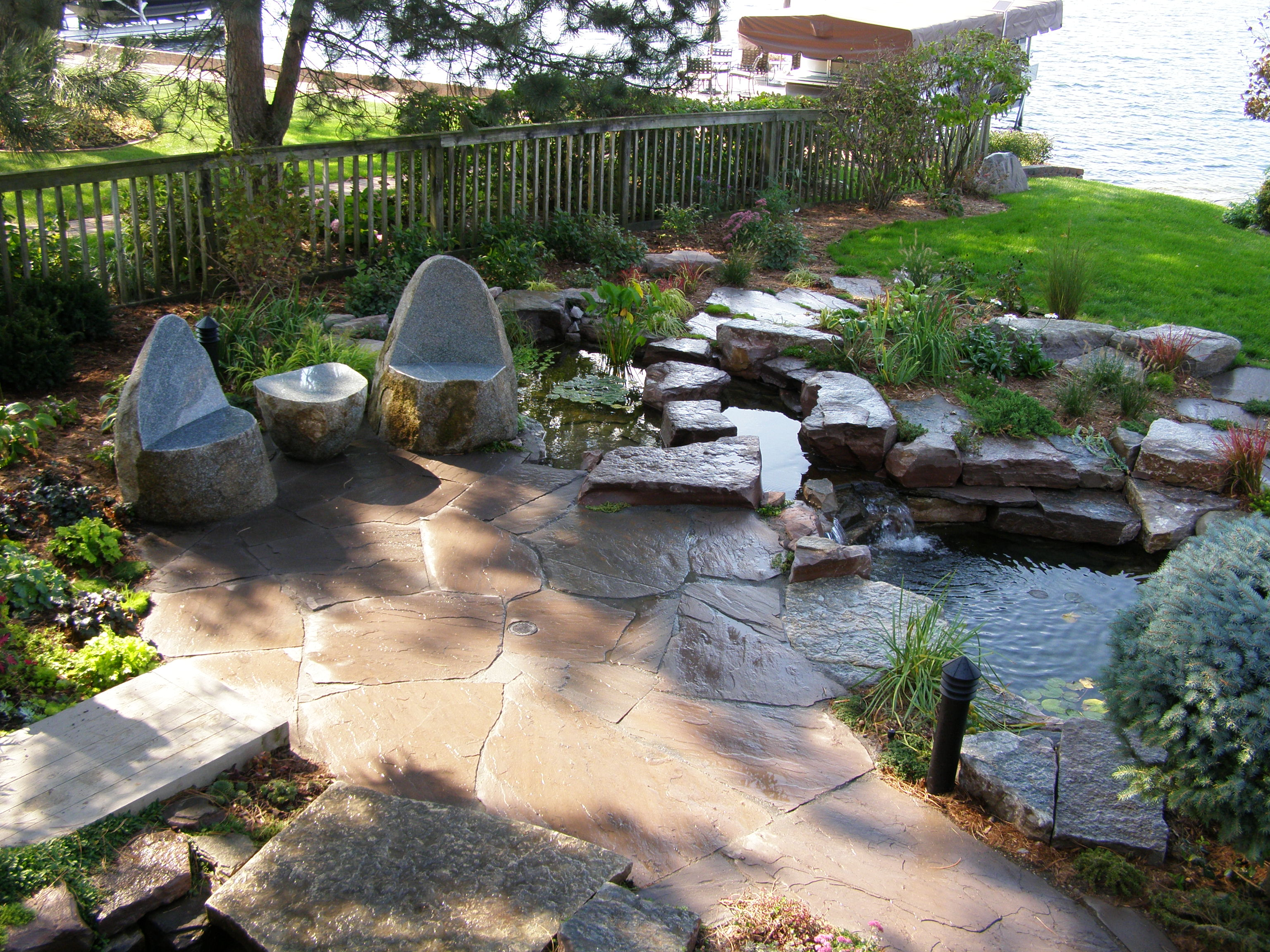 Natural stone patios and walkways in the utica ny area for Natural rock landscaping