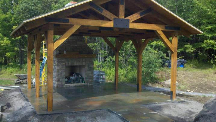 Fireplace in covered patio - Stone Age Landscaping